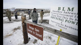 FILE - In this Monday, Jan. 4, 2016, file photo, members of the group occupying the Malheur National Wildlife Refuge headquarters stand guard near Burns, Ore. The divide in Oregon between the state's liberal, urban population centers and its conservative and economically depressed rural areas makes it fertile ground for the political crisis unfolding over a push by Democrats to enact sweeping climate legislation. Just three years after armed militia members took over the national wildlife refuge in southeastern Oregon, some of the same groups are now seizing on a walkout by Oregon's GOP senators to broadcast their anti-establishment message. (AP Photo/Rick Bowmer, File)