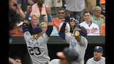 San Diego Padres' Manny Machado, right, celebrates his home run with Fernando Tatis Jr. (23) during the third inning of a baseball game against the Baltimore Orioles, Tuesday, June 25, 2019, in Baltimore. (AP Photo/Nick Wass)