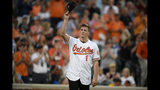 Baltimore Orioles first-round draft pick Adley Rutschman tips his cap to the crowd as he's introduced between innings of a baseball game against the San Diego Padres, Tuesday, June 25, 2019, in Baltimore. (AP Photo/Nick Wass)