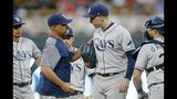 Tampa Bay Rays manager Kevin Cash, left, pulls starting pitcher Blake Snell, right, in the fourth inning of a baseball game, Tuesday, June 25, 2019, in Minneapolis. (AP Photo/Jim Mone)