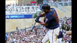 Minnesota Twins' Eddie Rosario hits an RBI single off Tampa Bay Rays pitcher Blake Snell in the third inning of a baseball game, Tuesday, June 25, 2019, in Minneapolis. (AP Photo/Jim Mone)