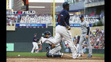 Minnesota Twins' Miguel Sano scores on a two-run single by Mitch Garver as Tampa Bay Rays catcher Austin Meadows, left, waits for the throw and pitcher Blake Snell, right, backs him up in the fourth inning of a baseball game, Tuesday, June 25, 2019, in Minneapolis. (AP Photo/Jim Mone)