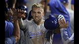 Kansas City Royals' Hunter Dozier is congratulated by teammates after hitting a grand slam in the ninth inning of a baseball game against the Cleveland Indians, Tuesday, June 25, 2019, in Cleveland. (AP Photo/Tony Dejak)