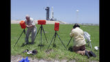 Photographers set up remote cameras to capture the launch of a SpaceX Falcon heavy rocket on pad 39A at the Kennedy Space Center in Cape Canaveral, Fla., Monday, June 24, 2019. The Falcon rocket scheduled to launch later this evening has a payload military and scientific research satellites. (AP Photo/John Raoux)