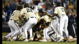 Vanderbilt players celebrate after defeating Michigan in Game 3 of the NCAA College World Series baseball finals in Omaha, Neb., Wednesday, June 26, 2019. (AP Photo/John Peterson)