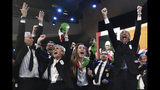 Members of Milan-Cortina delegation celebrate after winning the bid to host the 2026 Winter Olympic Games, during the first day of the 134th Session of the International Olympic Committee (IOC), at the SwissTech Convention Centre, in Lausanne, Switzerland, Monday, June 24, 2019. Italy will host the 2026 Olympics in Milan and Cortina d'Ampezzo, taking the Winter Games to the Alpine country for the second time in 20 years. (Philippe Lopez/Pool via AP)