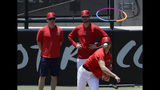 Los Angeles Angels' Shohei Ohtani, right, throws as pitching coach Doug White on in the bullpen before a baseball game against the Cincinnati Reds in Anaheim, Calif., Wednesday, June 26, 2019. Ohtani threw off a mound for the first time since Tommy John surgery Oct 1, 2018. (AP Photo/Chris Carlson)