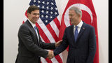 Acting U.S. Secretary for Defense Mark Esper, left, greets Turkish Defense Minister Hulusi Akar prior to a meeting of NATO defense ministers at NATO headquarters in Brussels, Wednesday, June 26, 2019. (AP Photo/Virginia Mayo, Pool)