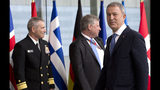 Turkish Defense Minister Hulusi Akar, right, arrives for a meeting of NATO defense ministers at NATO headquarters in Brussels, Wednesday, June 26, 2019. (AP Photo/Virginia Mayo, Pool)