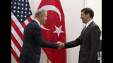 Acting U.S. Secretary for Defense Mark Esper, right, greets Turkish Defense Minister Hulusi Akar prior to a meeting of NATO defense ministers at NATO headquarters in Brussels, Wednesday, June 26, 2019. (AP Photo/Virginia Mayo, Pool)