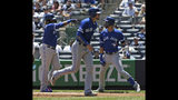 Toronto Blue Jays' Lourdes Gurriel Jr., right, celebrates his three-run home run with Cavan Biggio, center, and Vladimir Guerrero Jr. during the first inning of a baseball game against the New York Yankees at Yankee Stadium, Wednesday, June 26, 2019, in New York. (AP Photo/Seth Wenig)