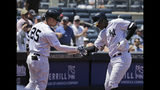 New York Yankees' Didi Gregorius, right, celebrates his solo home run with Gleyber Torres during the second inning of a baseball game against the Toronto Blue Jays at Yankee Stadium, Wednesday, June 26, 2019, in New York. (AP Photo/Seth Wenig)