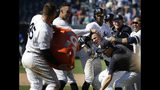 New York Yankees' Gleyber Torres, center right, celebrates his walk-off RBI single with teammates after the baseball game against the Toronto Blue Jays at Yankee Stadium, Wednesday, June 26, 2019, in New York. The Yankees defeated the Blue Jays 8-7. (AP Photo/Seth Wenig)