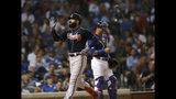 Atlanta Braves' Nick Markakis left, celebrates at home plate after hitting a three-run home run while Chicago Cubs catcher Willson Contreras right, waits during the third inning of a baseball game Wednesday, June 26, 2019, in Chicago. (AP Photo/Paul Beaty)
