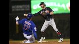 Atlanta Braves shortstop Dansby Swanson right, throws to first base after forcing out Chicago Cubs' Kris Bryant (17) at second base, on a double play hit into by Anthony Rizzo during the third inning of a baseball game Wednesday, June 26, 2019, in Chicago. (AP Photo/Paul Beaty)