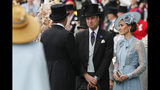 Kate, Duchess of Cambridge, right, and Prince William arrive on the day one of the annual Royal Ascot horse race meeting in Ascot, England, Tuesday, June 18, 2019. (AP Photo/Alastair Grant)