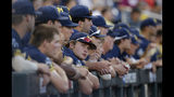 Michigan pitcher Willie Weiss, center, looks toward the scoreboard from the dugout during the seventh inning of Game 3 of the NCAA College World Series baseball finals against Vanderbilt in Omaha, Neb., Wednesday, June 26, 2019. (AP Photo/Nati Harnik)