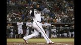 Arizona Diamondbacks' Eduardo Escobar watches the flight of his three-run home run against the Los Angeles Dodgers during the first inning of a baseball game Wednesday, June 26, 2019, in Phoenix. (AP Photo/Ross D. Franklin)
