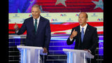 Democratic presidential candidates Washington Gov. Jay Inslee , left and former Maryland Rep. John Delaney answer a question at the same time during a Democratic primary debate hosted by NBC News at the Adrienne Arsht Center for the Performing Arts, Wednesday, June 26, 2019, in Miami. (AP Photo/Wilfredo Lee)