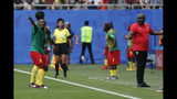 Cameroon's Ajara Nchout, left, and Cameroon head coach Alain Djeumfa react after a VAR decision that ruled out Cameroon's Ajara Nchout's goal for offside during the Women's World Cup round of 16 soccer match between England and Cameroon at the Stade du Hainaut stadium in Valenciennes, France, Sunday, June 23, 2019. (AP Photo/Michel Spingler)