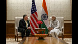 Secretary of State Mike Pompeo, left, talks with Indian Prime Minister Narendra Modi, during their meeting at the Prime Minister's Residence, Wednesday, June 26, 2019, in New Delhi, India. (AP Photo/Jacquelyn Martin, Pool)