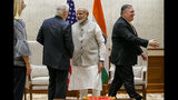 Indian Prime Minister Narendra Modi, center, shakes hands with U.S. Ambassador to India Kenneth Juster, left, as Secretary of State Mike Pompeo, walks to shake hands with the Indian delegation, at the start of their meeting at the Prime Minister's Residence, Wednesday, June 26, 2019, in New Delhi, India. (AP Photo/Jacquelyn Martin, Pool)