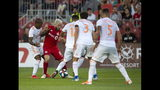 Toronto FC midfielder Alejandro Pozuelo (10) battles for the ball against Atlanta United players, including Miles Robinson, Michael Parkhurst (3) and Leandro Gonzalez Pirez during the first half of an MLS soccer match Wednesday, June 26, 2019, in Toronto. (Andrew Lahodynskyj/The Canadian Press via AP)