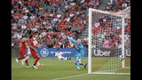 Toronto FC midfielder Alejandro Pozuelo, left, scores a goal against Atlanta United goalkeeper Brad Guzan during the first half of an MLS soccer match Wednesday, June 26, 2019, in Toronto. (Andrew Lahodynskyj/The Canadian Press via AP)