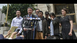 Attorney Wang Zhidong, surrounded by family members of slain University of Illinois scholar Yingying Zhang, addresses the media after a jury found Brendt Christensen guilty of her murder Monday, June 24, 2019 outside the U.S. Federal Courthouse in Peoria, Illinois. (Matt Dayhoff/Journal Star via AP)