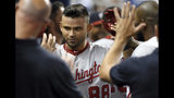 Washington Nationals' Gerardo Parra (88) is congratulated by teammates after scoring against the Miami Marlins during the ninth inning of a baseball game, Wednesday, June 26, 2019, in Miami. (AP Photo/Jim Rassol)