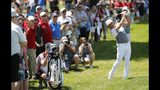 Rickie Fowler hits his second shot on the 18th hole during Pro-Am at the Rocket Mortgage Classic golf tournament, Wednesday, June 26, 2019, in Detroit. (AP Photo/Carlos Osorio)