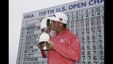 FILE - In this June 16, 2019, file photo, Gary Woodland kisses the U.S. Open trophy after winning the golf tournament in Pebble Beach, Calif. Woodland is making his first start since winning the U.S. Open, hoping to keep his game sharp at the Rocket Mortgage Classic a few weeks before the British Open. (AP Photo/Carolyn Kaster, File)