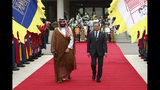 South Korean President Moon Jae-in, right, and Saudi Crown Prince Mohammed bin Salman view an honor guard during a welcoming ceremony at the presidential Blue House, Wednesday, June 26, 2019, in Seoul, South Korea. Bin Salman is visiting South Korea for two days - the first time by an heir to the throne of Saudi Arabia since 1998. (Chung Sung-Jun/Pool Photo via AP)