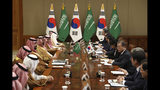 South Korean President Moon Jae-in, right, talks with Saudi Crown Prince Mohammed bin Salman, fifth left, during a meeting at the presidential Blue House, Wednesday, June 26, 2019, in Seoul, South Korea. Bin Salman is visiting South Korea for two days - the first time by an heir to the throne of Saudi Arabia since 1998. (Chung Sung-Jun/Pool Photo via AP)