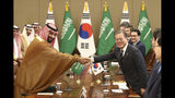 South Korean President Moon Jae-in, right, shakes hands with Saudi Crown Prince Mohammed bin Salman during a meeting at the presidential Blue House, Wednesday, June 26, 2019, in Seoul, South Korea. Bin Salman is visiting South Korea for two days - the first time by an heir to the throne of Saudi Arabia since 1998. (Chung Sung-Jun/Pool Photo via AP)