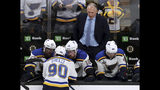 St. Louis Blues head coach Craig Berube, right, watches as Ryan O'Reilly (90) speaks to teammates on the bench during the second period in Game 7 of the NHL hockey Stanley Cup Final against the Boston Bruins, Wednesday, June 12, 2019, in Boston. (AP Photo/Charles Krupa)