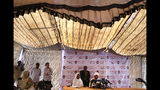 Sadek al-Mahdi, right, who heads the Umma party, speaks during a press conference inside a tent at the backyard of his group headquarters, in Khartoum, Sudan, Wednesday, June 26, 2019. Al-Mahdi who leading Sudanese opposition figure says the African Union and Ethiopia have joined forces in renewed efforts to mediate the crisis in Sudan and bring the ruling generals and protest leaders back to the negotiating table.(AP Photo/Hussein Malla)