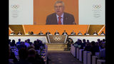 International Olympic Committee, IOC, President Thomas Bach from Germany speaks during the 134th Session of the International Olympic Committee (IOC), at the SwissTech Convention Centre, in Lausanne, Switzerland, Tuesday, June 25, 2019. (Jean-Christophe Bott/Keystone via AP)