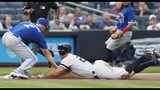 Toronto Blue Jays starting pitcher Clayton Richard, left, tags out New York Yankees' Giancarlo Stanton at third during the first inning of a baseball game Tuesday, June 25, 2019, in New York. Stanton left the game after the third inning. (AP Photo/Kathy Willens)