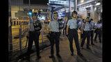 Riot police stand guard outside the police headquarters as thousands gathered to demand for an independent inquiry into a heavy-handed police crackdown at a protest earlier this month, in Hong Kong during the early hours of Thursday, June 27, 2019. Thousands of people joined Hong Kong's latest protest rally Wednesday night against legislation they fear would erode the city's freedoms, capping a daylong appeal to world leaders ahead of a G-20 summit this week that brings together the heads of China, the United States and other major nations. (AP Photo/Kin Cheung)