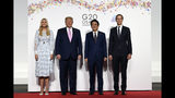 President Donald Trump poses for a photo with Japanese Prime Minister Shinzo Abe and Ivanka Trump and senior advisor Jared Kushner ahead of a meeting on the sidelines of the G-20 summit in Osaka, Japan, Friday, June 28, 2019. (AP Photo/Susan Walsh)