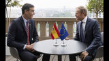Spanish Prime Minister Pedro Sanchez, left, speaks with European Council President Donald Tusk during a meeting on the sidelines of an EU summit in Brussels, Sunday, June 30, 2019. (AP Photo/Virginia Mayo, Pool)