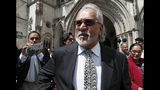 Indian business man Vijay Mallya leaves the High Court for a lunch break as he appeals against extradition to India to face fraud charges at the Royal Courts of Justice in London, Tuesday, July 2, 2019. Mallya, whose business empire once included Kingfisher beer, left India two and a half years ago after defaulting on debts of more than a billion dollars linked to a failing venture, Kingfisher Airlines. (AP Photo/Alastair Grant)