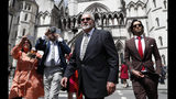 Indian tycoon Vijay Mallya, high Court appeal against extradition to India to face fraud charges at the Royal Courts of Justice in London, Tuesday, July 2, 2019. Mallya, whose business empire once included Kingfisher beer, left India two and a half years ago after defaulting on debts of more than a billion dollars linked to a failing venture, Kingfisher Airlines.(AP Photo/Alastair Grant)