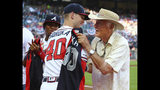 Atlanta Braves pitcher Mike Soroka receives his All-Star jersey from former Braves pitcher Phil Niekro, with fellow All-Star Ronald Acuna Jr. applauding before the team's baseball game against the Philadelphia Phillies on Tuesday, July 2, 2019, in Atlanta. (Curtis Compton/Atlanta Journal-Constitution via AP)