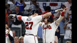 Atlanta Braves' Austin Riley (27) celebrates with Josh Donaldson after hitting a three-run home run in the sixth inning of a baseball game against the Philadelphia Phillies Wednesday, July 3, 2019, in Atlanta. (AP Photo/John Bazemore)