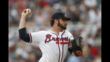 Atlanta Braves starting pitcher Bryse Wilson (46) works against the Philadelphia Phillies in the first inning of a baseball game Wednesday, July 3, 2019, in Atlanta. (AP Photo/John Bazemore)