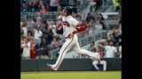 Atlanta Braves' Josh Donaldson rounds the bases after hitting a a three-run home run in the fourth inning of a baseball game against the Philadelphia Phillies Wednesday, July 3, 2019, in Atlanta. (AP Photo/John Bazemore)
