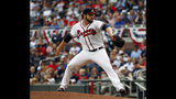 Atlanta Braves starting pitcher Bryse Wilson works in the first inning of a baseball game against the Philadelphia Phillies Wednesday, July 3, 2019, in Atlanta. (AP Photo/John Bazemore)