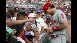 Philadelphia Phillies right fielder Bryce Harper (3) signs autographs for fans before a baseball game against the Atlanta Braves Wednesday, July 3, 2019, in Atlanta. (AP Photo/John Bazemore)